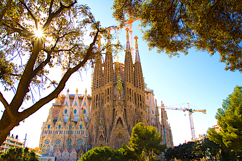 The Art Nouveau spires of La Sagrada Familia rise over Barcelona